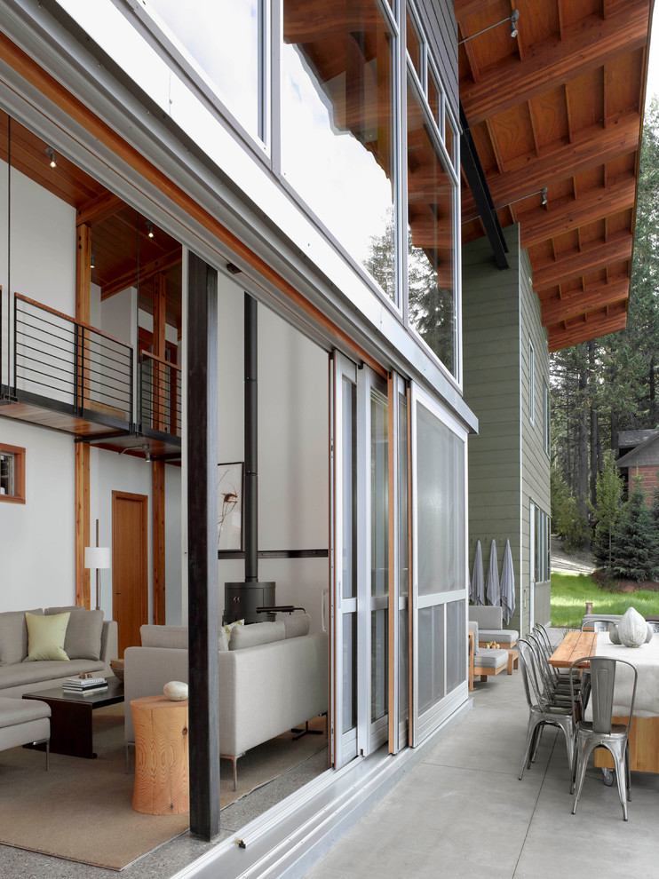 Andersen Sliding Doors Exterior Contemporary with Angled Roof Concrete Pavers Concrete Slab Exterior