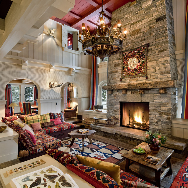 andirons Living Room Rustic with andiron antler sconce butterflies chandelier Fireplace high ceiling kilim