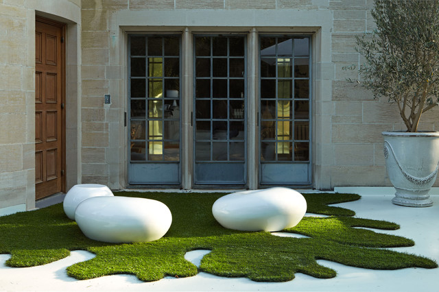 artificial turf cost Landscape Contemporary with courtyard cut grass doorway french doors limestone Olive tree