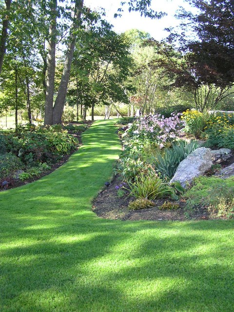 Atlantic Pest Control Landscape Traditional with Border Plantings Boulders Garden Grass Lawn Path Playset Rocks