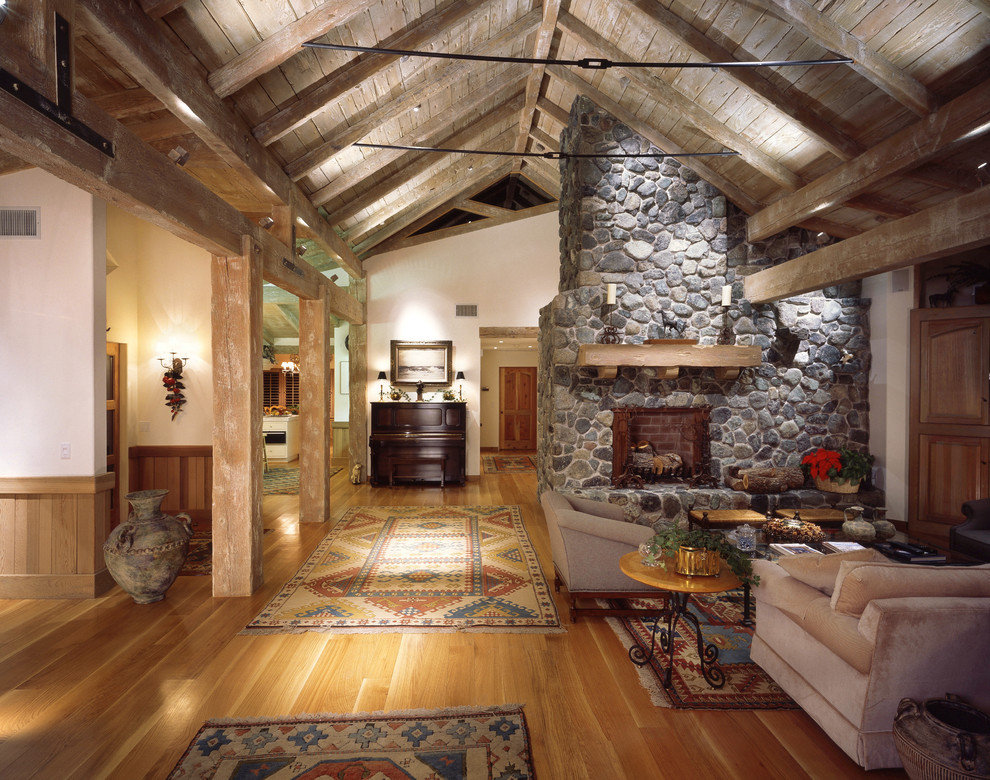 Aztec rug living room eclectic with art lighting couch for Country stone fireplace