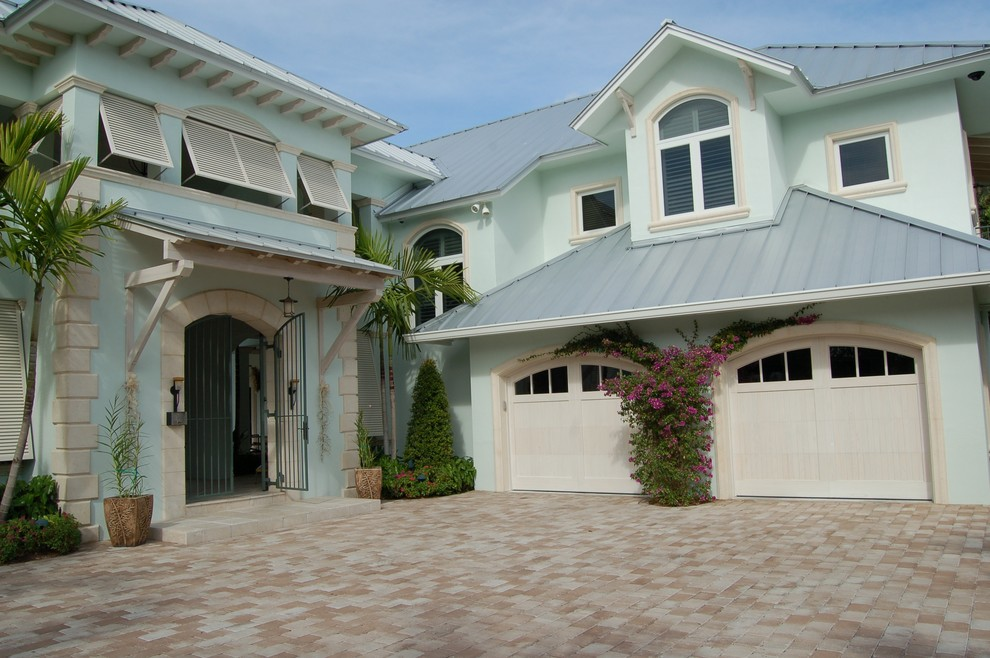 Bermuda Shutters Exterior Tropical with Arched Garage Door Arched Window Awning Windows