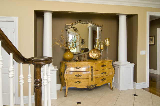 bombay chests Entry Traditional with accent wall banister baseboards bombe chest columns crown molding