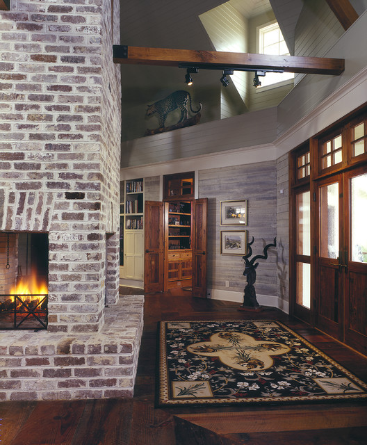 Brick Veneer Panels Entry Farmhouse with Brick Fireplace Ceiling Lighting Crown Molding Dormer Exposed Beams