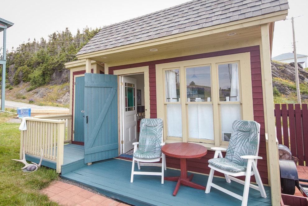 Bunkie Boards Exterior Beach with Blue Door Brick Red Siding Brick Red