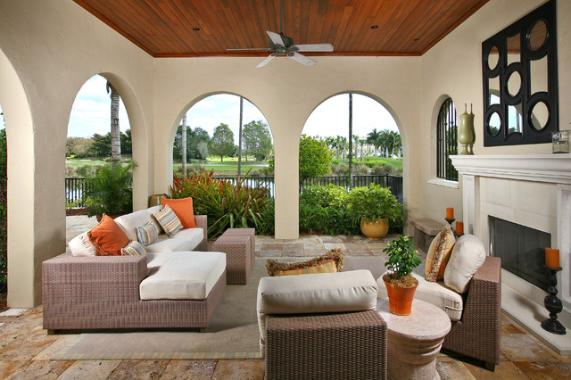 Burglar Bars Patio Mediterranean with Arched Doorways Area Rug Ceiling Fan Landscaping Mass Planting