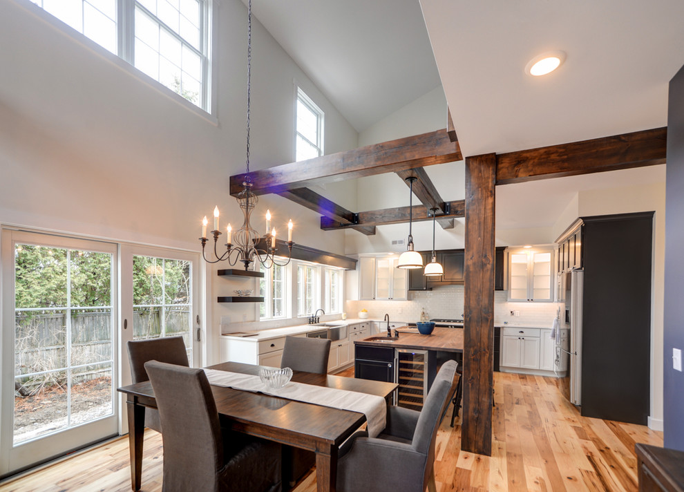 butcher block desk dining room with accent wall black white exposed beams exposed