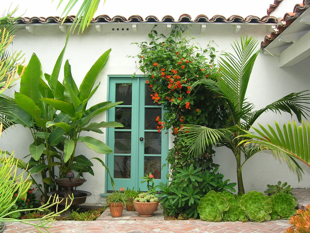 Cal Flame Landscape Tropical with Brick Green French Doors Lush Orange Vine Palms Path