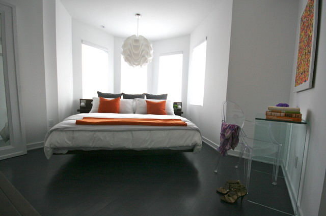 Cal King Platform Bed Bedroom Modern with Bay Window Clear Plastic Chair Clear Table Dark Floor