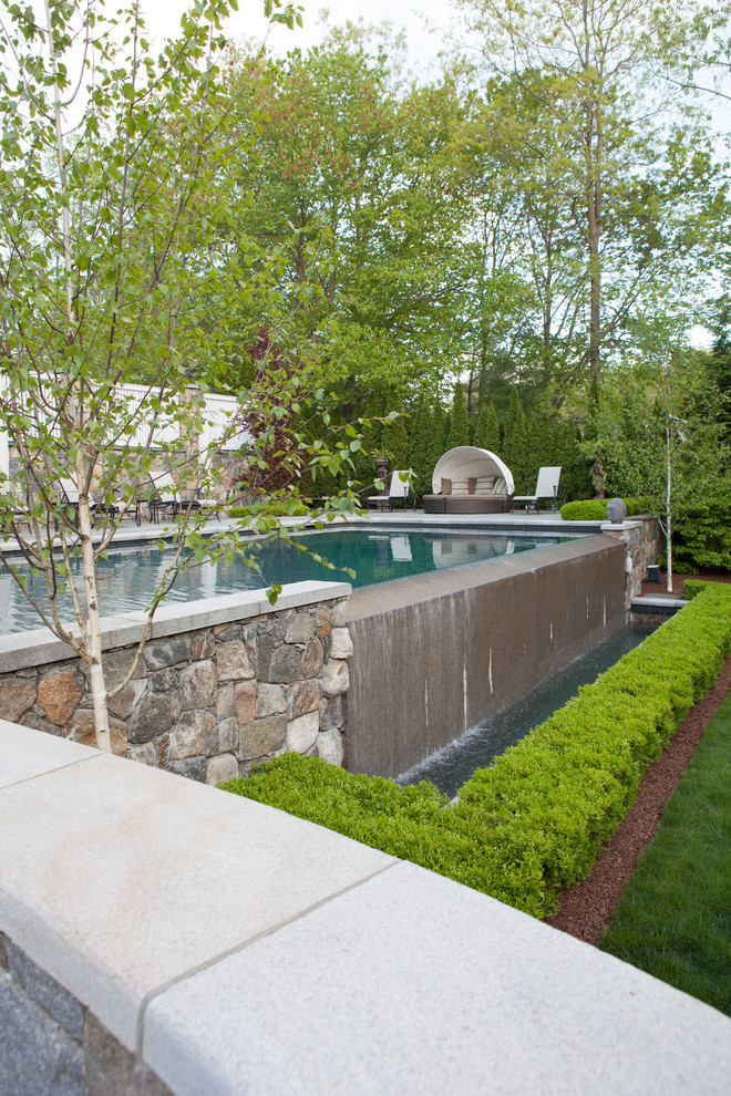 Canopy Daybed Pool Traditional with Boxwood Holly Hornbeam Landscaping Stone Wall Waterfall