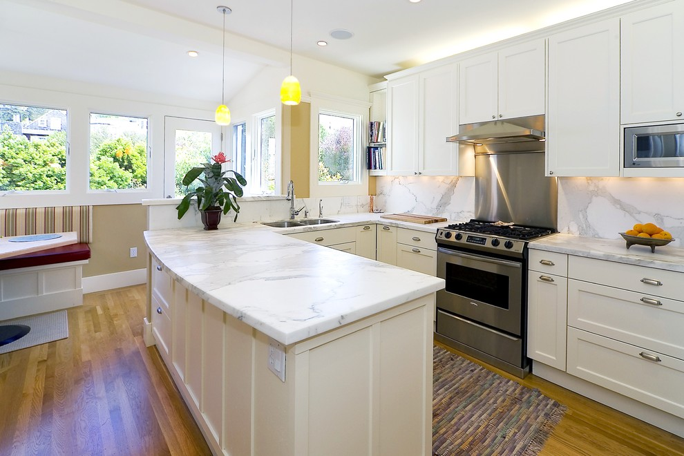Carrara Marble Countertop Kitchen Traditional with Banquette Seating Bookshelves Breakfast Nook Marble Backsplash