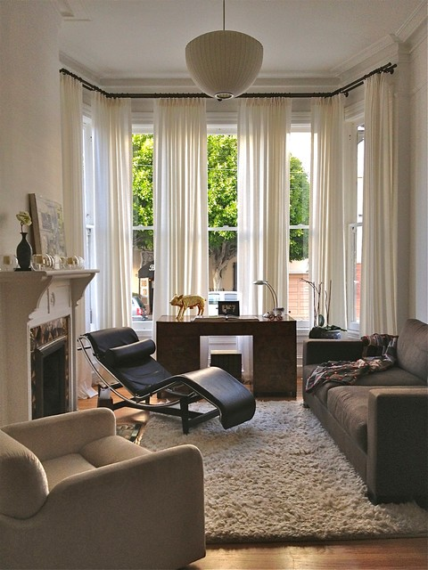 ceiling mounted curtain rods Living Room Eclectic with black leather lounge chair contemporary desk drapery gold pig