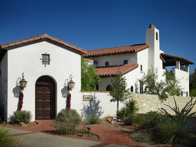 chili pepper lights Exterior Mediterranean with arched doorway arid carved wood door courtyard wall entrance