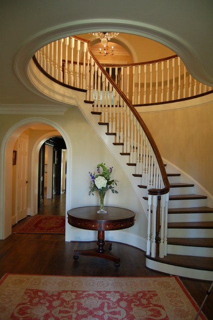 circular staircase Staircase Traditional with chandelier curved staircase hallway red oriental rug Rent Table
