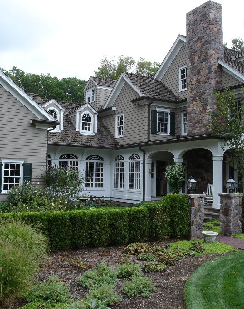 Clapboard Siding Exterior Traditional with Arched Doorway Arched Transom Windows Arched Windows