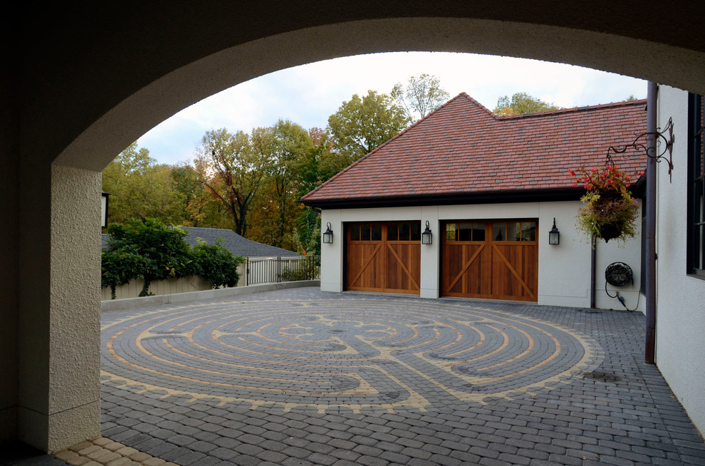 Cobblestone Driveway Garage and Shed Contemporary with Arch Carriage Style Wood Garage Doors Clay