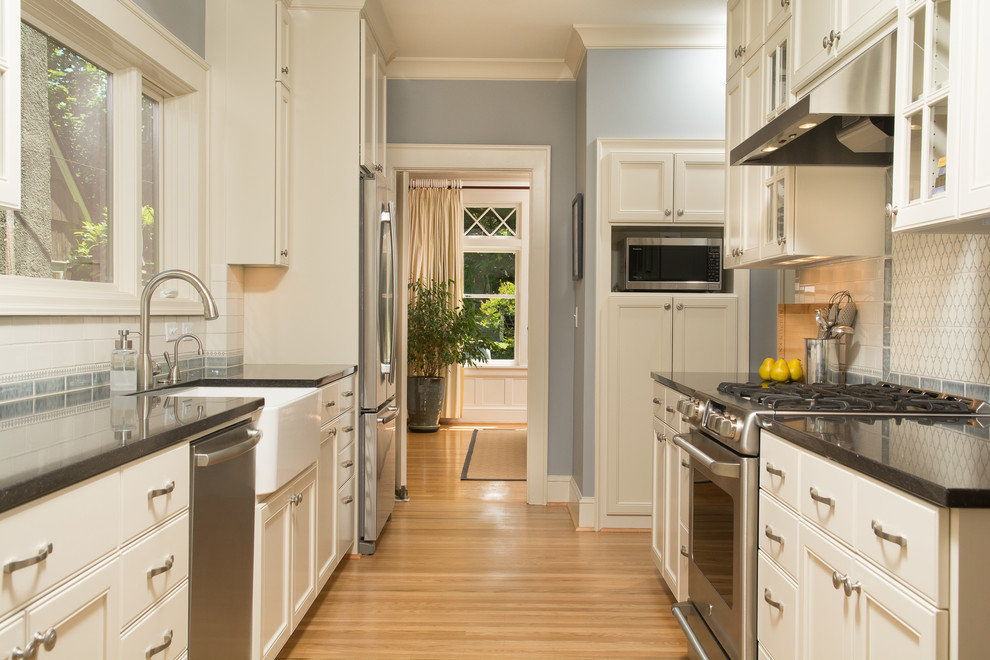 Composite Countertops Kitchen Traditional with Blue Walls Glass Front Cabinets Narrow Space