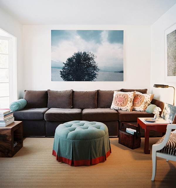 Convertible Couch Living Room Eclectic with Artwork Decorative Pillows Magazine Storage Stacked Books Throw Pillows