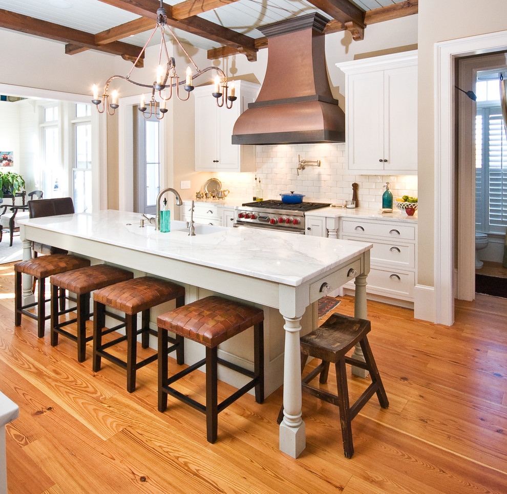 Copper Range Hood Kitchen Traditional with Baseboards Breakfast Bar Ceiling Treatment Chandelier Coffered