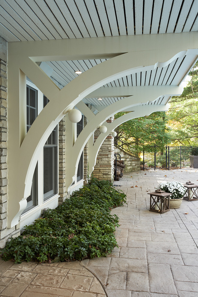 Corbels Exterior Traditional with Corbels Iron Fence Lanterns Overhang Pavers Stone