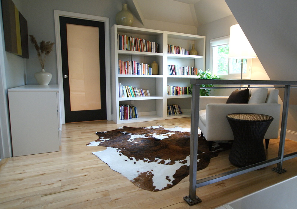 cowhide rug family room contemporary with area rug bookcase bookshelves cowhide cowhide rug animal hide rugs home office traditional