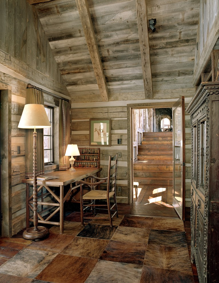 cowhide rug home office rustic with carved wood armoire chincking cowhide rug floor animal hide rugs home office traditional