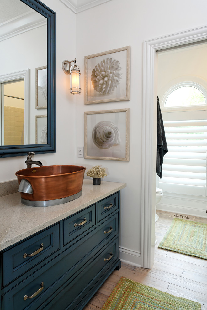 Delta Cassidy Faucet Bathroom Contemporary with Antique Brass Pulls Arch Window Blue Cabinet