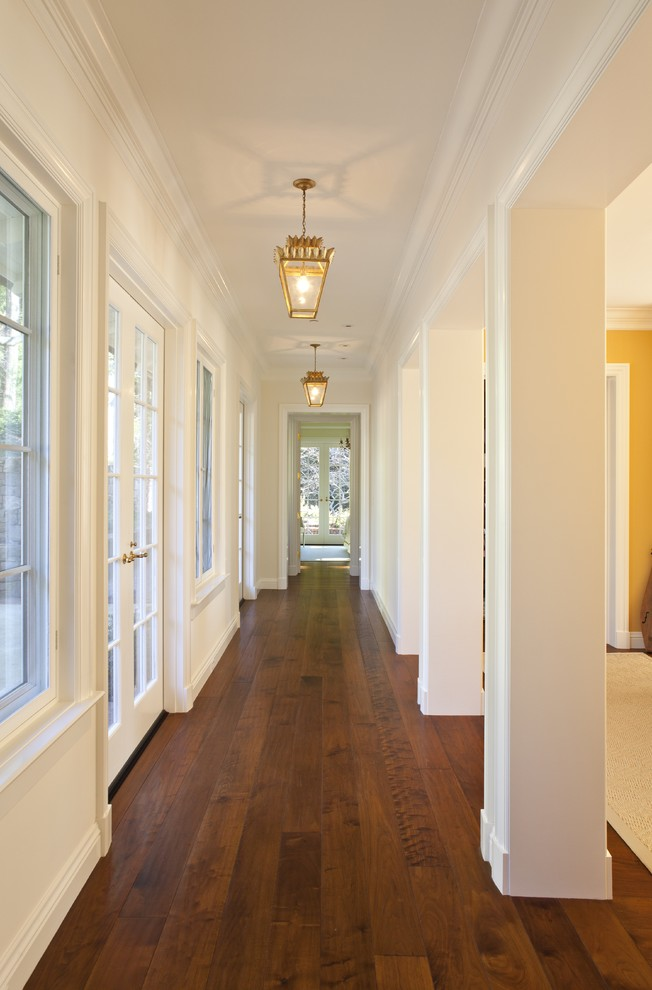 Distressed Hardwood Flooring Hall Traditional with Baseboards Columns Crown Molding Dark Floor French