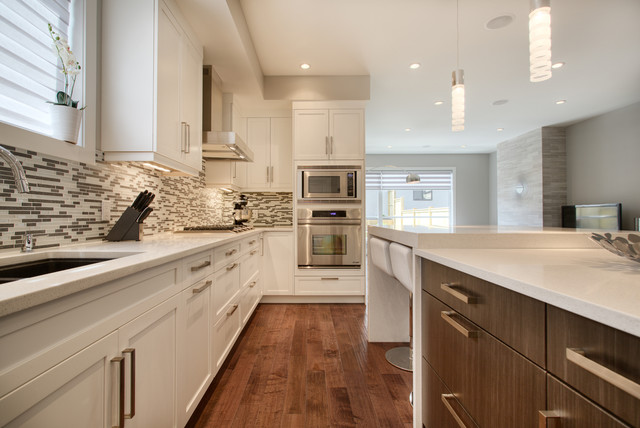 Distressed Hardwood Flooring Kitchen Contemporary with Counters Stools Flat Panel Cabinets Frame and Panel Hood