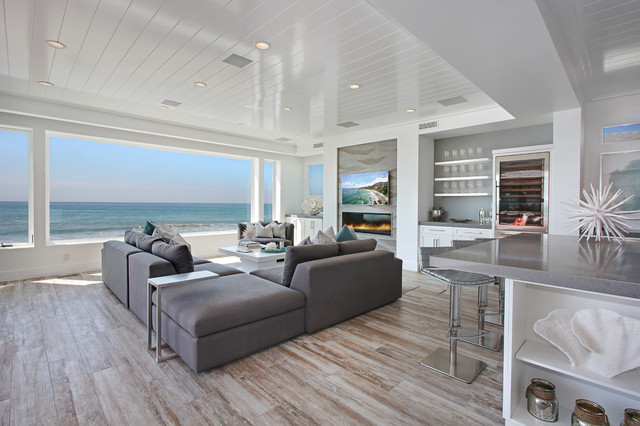 Distressed Hardwood Flooring Living Room Beach with Beach Front Gray Bar Stools Gray Countertop Gray Sectional