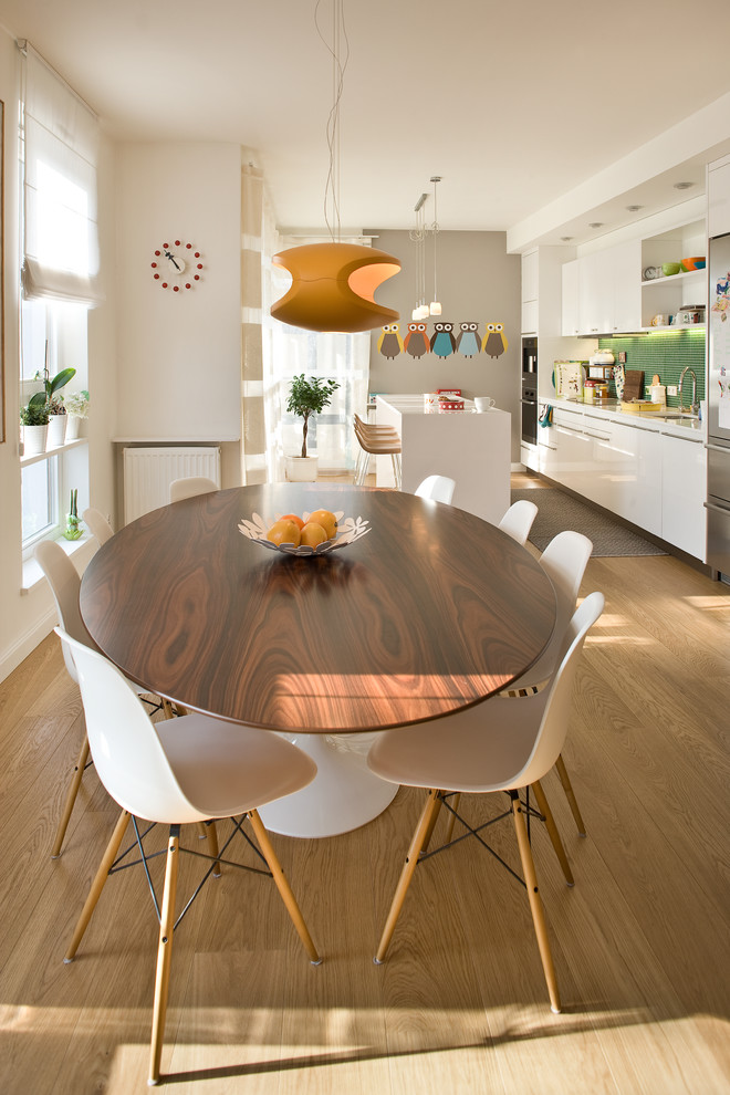 Double Pedestal Dining Table Dining Room Contemporary with Eames Chair Orange Pendant Light Tulip Table