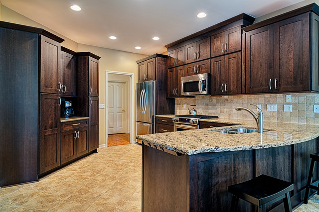 Duraceramic Kitchen Traditional with Angle Outlet Cambria Cherry Cabinets Chrome Sink Dark Cabinets