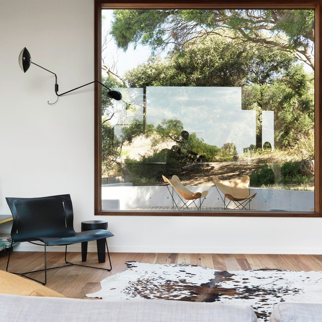 Egress Window Cost Living Room Contemporary with Animal Skin Rug Butterfly Chair Butterfly Chairs Cowhide Rug