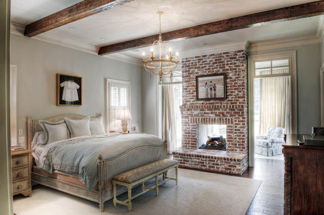 Electric Fireplace Insert Bedroom Traditional with Area Rug Bench Seat Brick Fireplace Carved Wood Chandelier