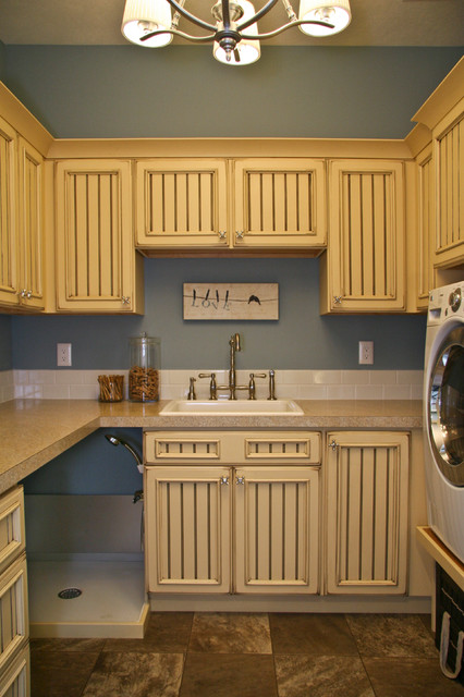 Elevated Dog Feeder Laundry Room Traditional with Artwork Beadboard Chandelier Frame and Panel Cabinets Gray Walls