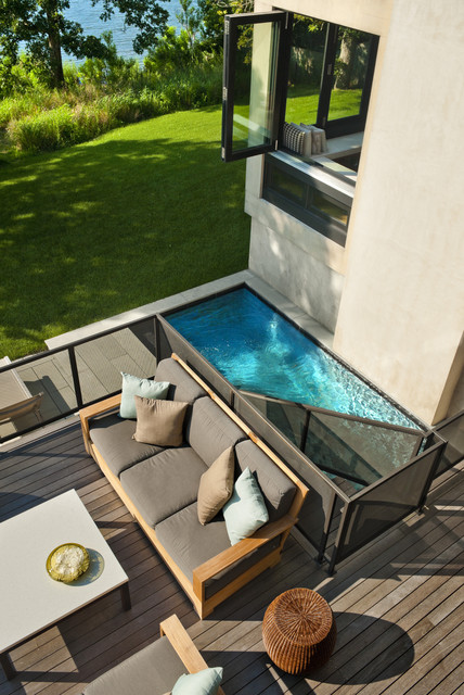 endless pool cost Deck Beach with casement windows coastal deck grass lawn lounge outdoor cushions