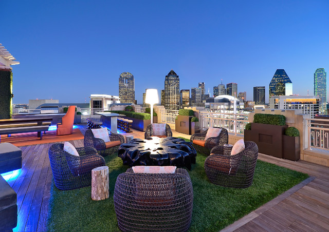 fake grass cost Deck Modern with accent table ambient lighting counter counter stools grass hedges