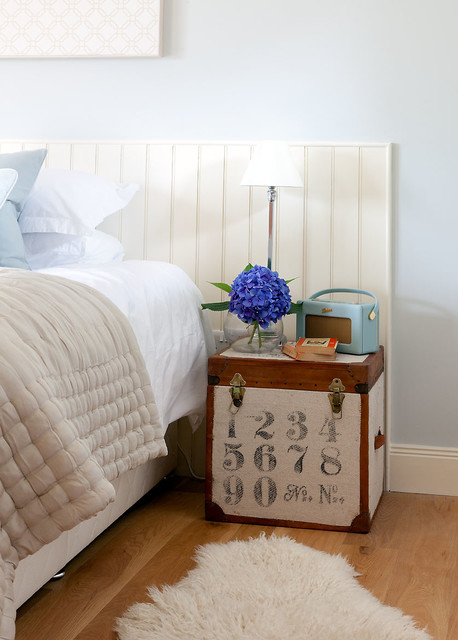 Faux Sheepskin Rug Bedroom Transitional with Bedside Table Beige Bedding Blue Bedroom Headboard Latches Pale