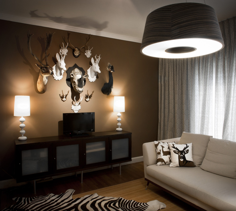 Faux Taxidermy Family Room Contemporary with Animal Bust Animal Prints Brown Walls Credenza
