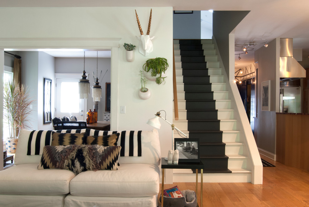 faux taxidermy Living Room Eclectic with black and white staircase black and white