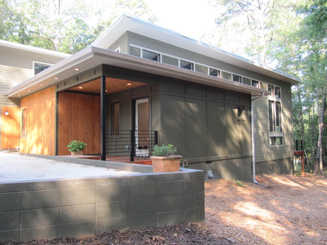 Fiber Cement Siding Exterior Modern with Concrete Block Flat Roof Green Green House Overhang Patio