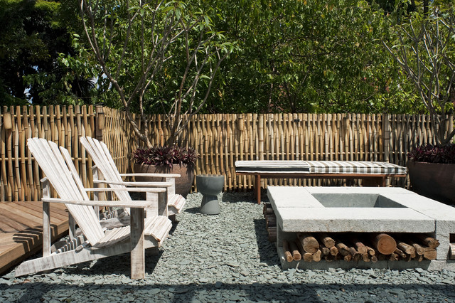 Fire Wood Rack Patio Tropical with Adirondack Chairs Bamboo Fence Container Plants Firewood Storage Outdoor