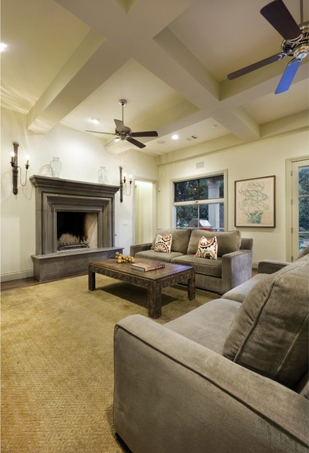 Fireplace Mantels and Surrounds Family Room Traditional with Area Rug Ceiling Fan Coffered Ceiling Decorative Pillows Double