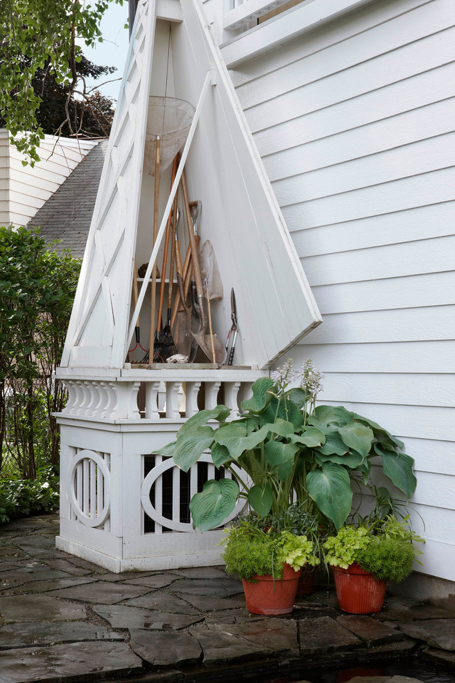 Firewood Storage Shed Garage and Shed Traditional with Clapboard Flagstone Lap Siding Lattice Potted Plants