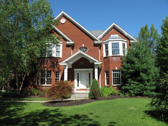 Fluted Columns Exterior Traditional with Brick House Container Garden White Columns White Front Door