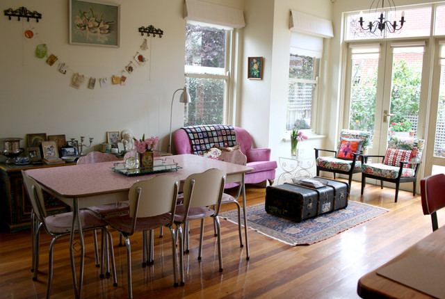 Formica Table Spaces Shabby Chic with Antique Trunk Bold Colors Chandelier Double Hung Windows French
