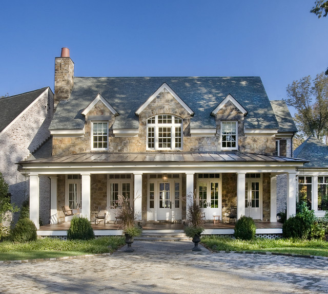 Foundation Repair Kansas City Exterior Traditional with Columns Covered Patio French Doors Outdoor Seating Porch Rocking