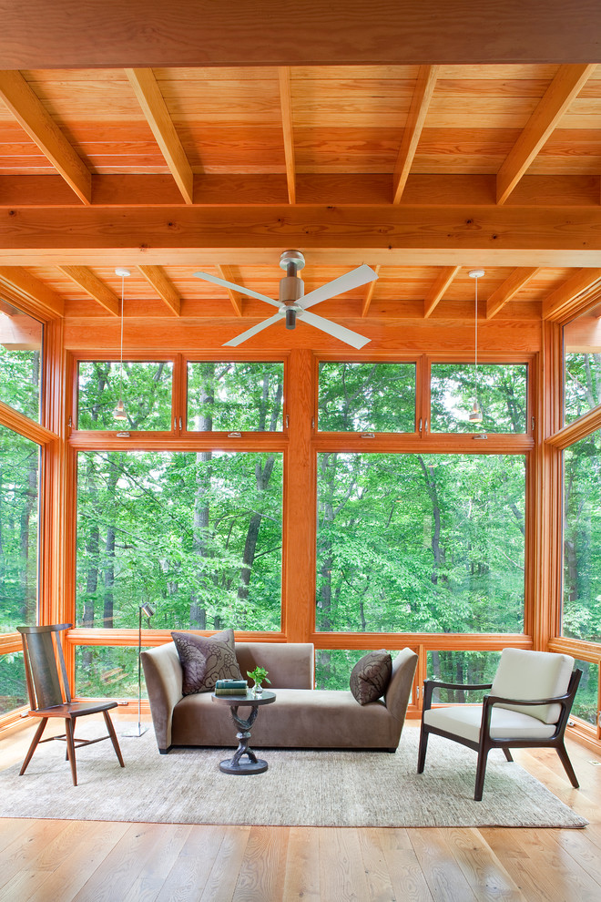 Four Seasons Sunrooms Sunroom Eclectic with Brown Sofa Ceiling Fan Dark Wood Side