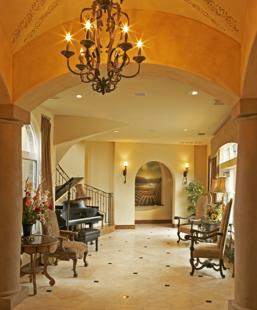 Foyer chandeliers wine cellar contemporary with candle chandelier foyer chandeliers entry mediterranean with archway baseboards ceiling lighting chandelier columns floor arubaitofo Images