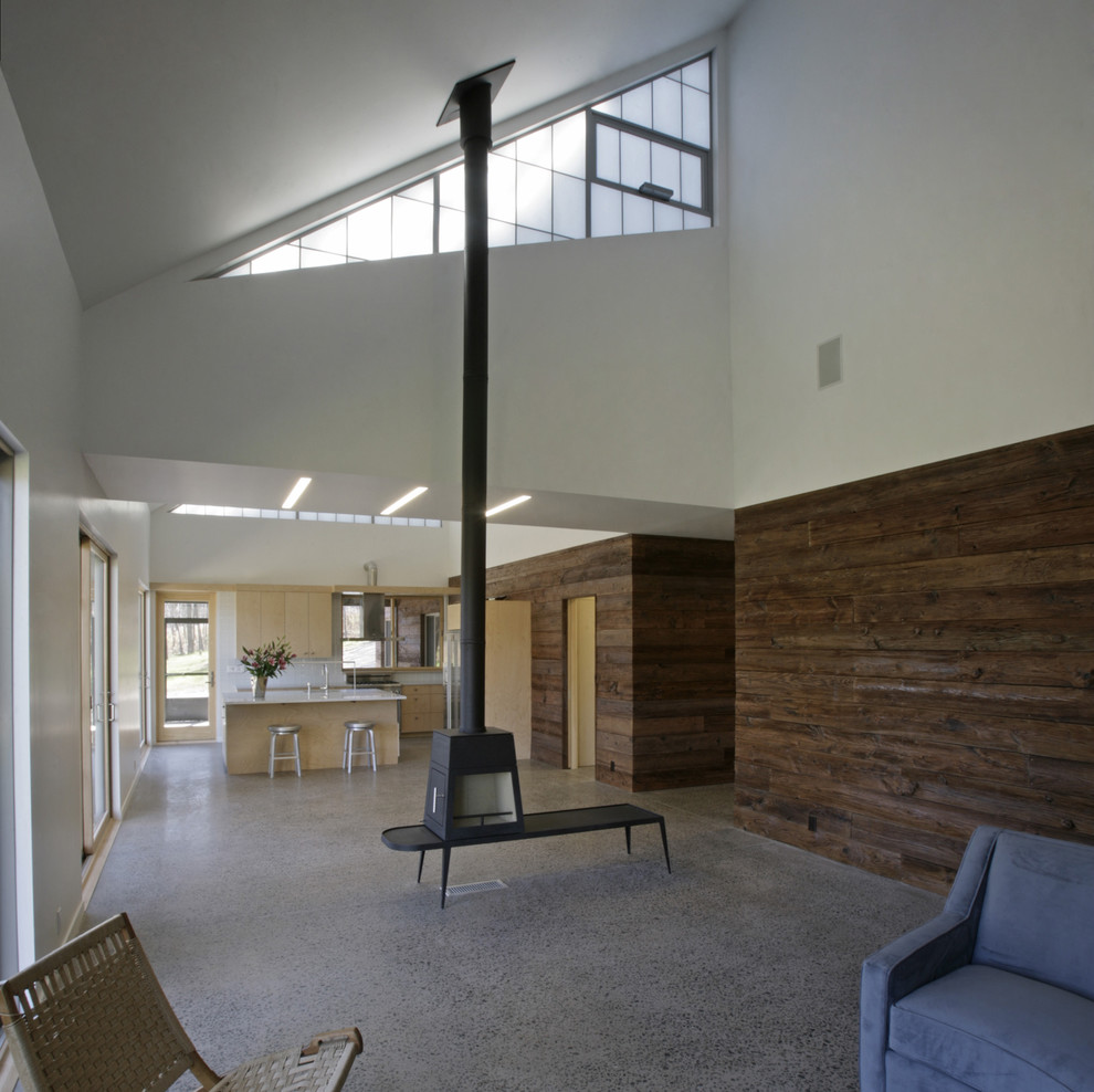 Freestanding Fireplace Living Room Modern with Awning Windows Chimney Clerestory Concrete Floors Cypress